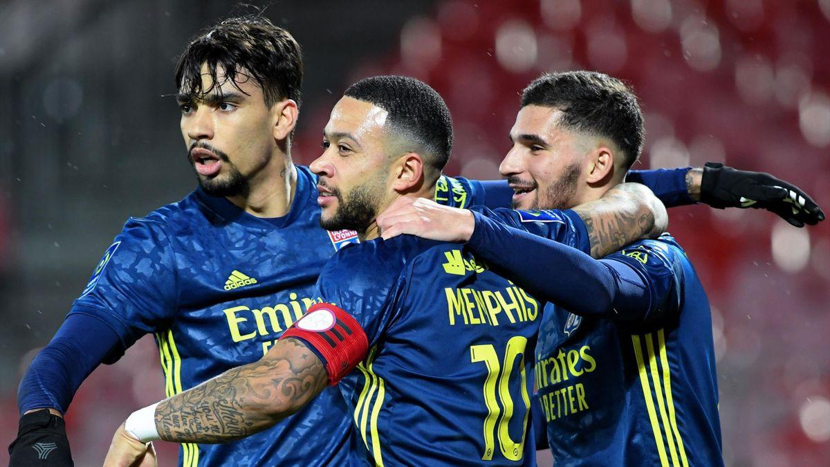 Lyon's French midfielder Houssem Aouar (R) celebrates with teammates Lyon's Dutch forward Memphis Depay (C) and Lyon's Brazilian midfielder Lucas Paqueta (L)