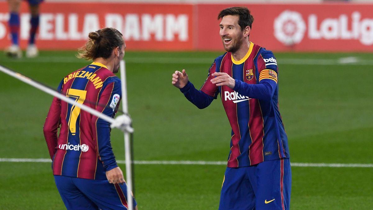 Barcelona's French midfielder Antoine Griezmann celebrates his goal with Barcelona's Argentine forward Lionel Messi