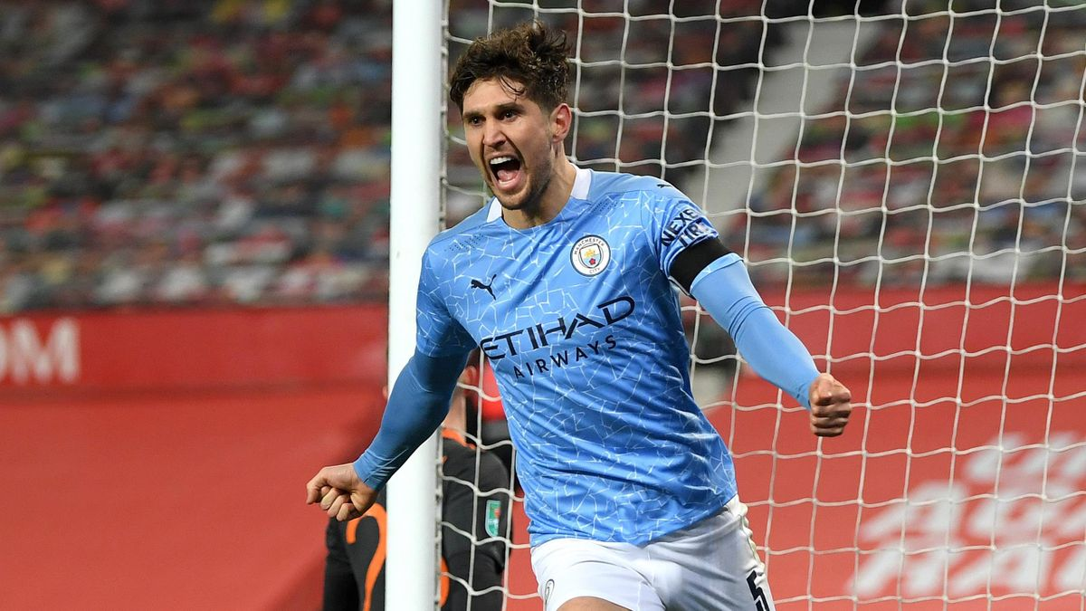 John Stones celebrates scoring the opener for Manchester City v Manchester United