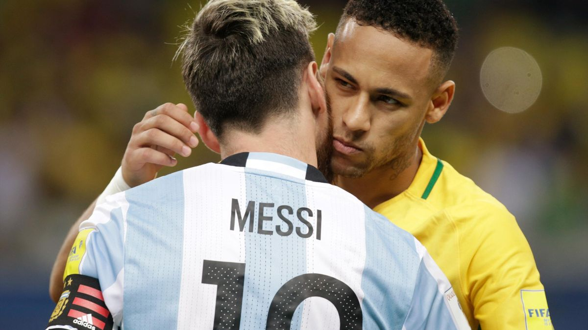 Brazil's Neymar (R) greets Argentina's Lionel Messi