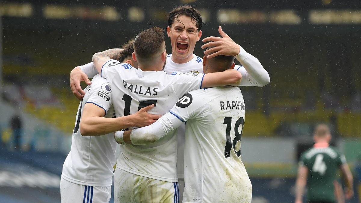 Rodrigo of Leeds United celebrates with Stuart Dallas and Raphinha after scoring their side's third goal during the Premier League match between Leeds United and Tottenham Hotspur at Elland Road on May 08, 2021 in Leeds, England.