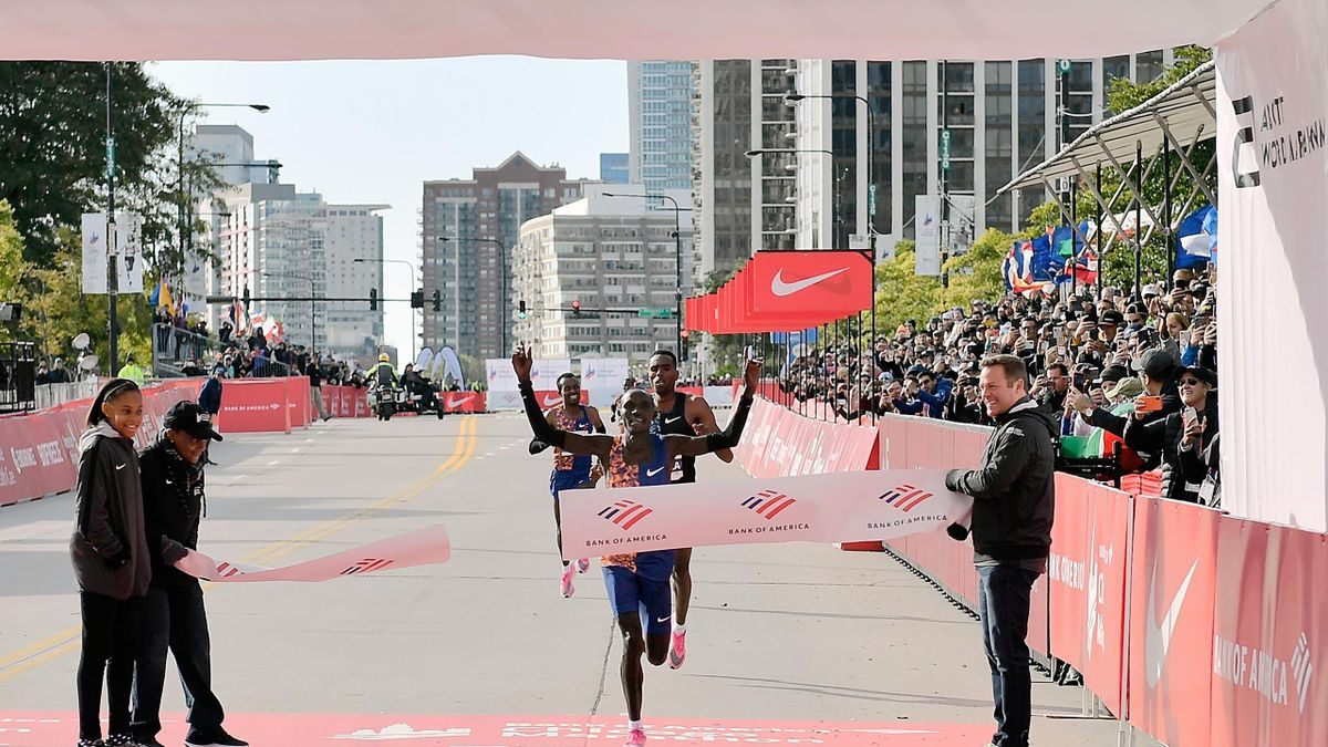 Lawrence Cherono of Kenya wins the men's race past Dejene Debela of Ethiopia during the 2019 Bank of America Chicago Marathon on October 13, 2019 in Chicago, Illinois.
