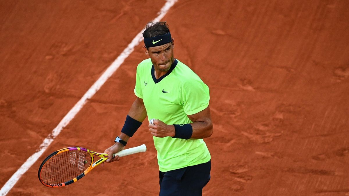 Spain's Rafael Nadal reacts during his men's singles semi-final tennis match against Serbia's Novak Djokovic on Day 13 of The Roland Garros 2021 French Open tennis tournament in Paris on June 11, 2021. (Photo by Christophe ARCHAMBAULT / AFP) (Photo by CHR