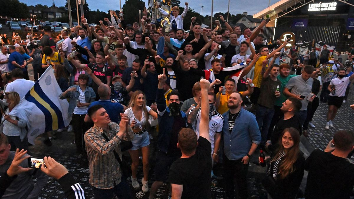 Leeds United supporters gather outside their Elland Road ground to celebrate the club's return to the Premier League after a gap of 16 years, in Leeds, northern England on July 17, 2020. - Leeds United were promoted to the Premier League on Friday after W