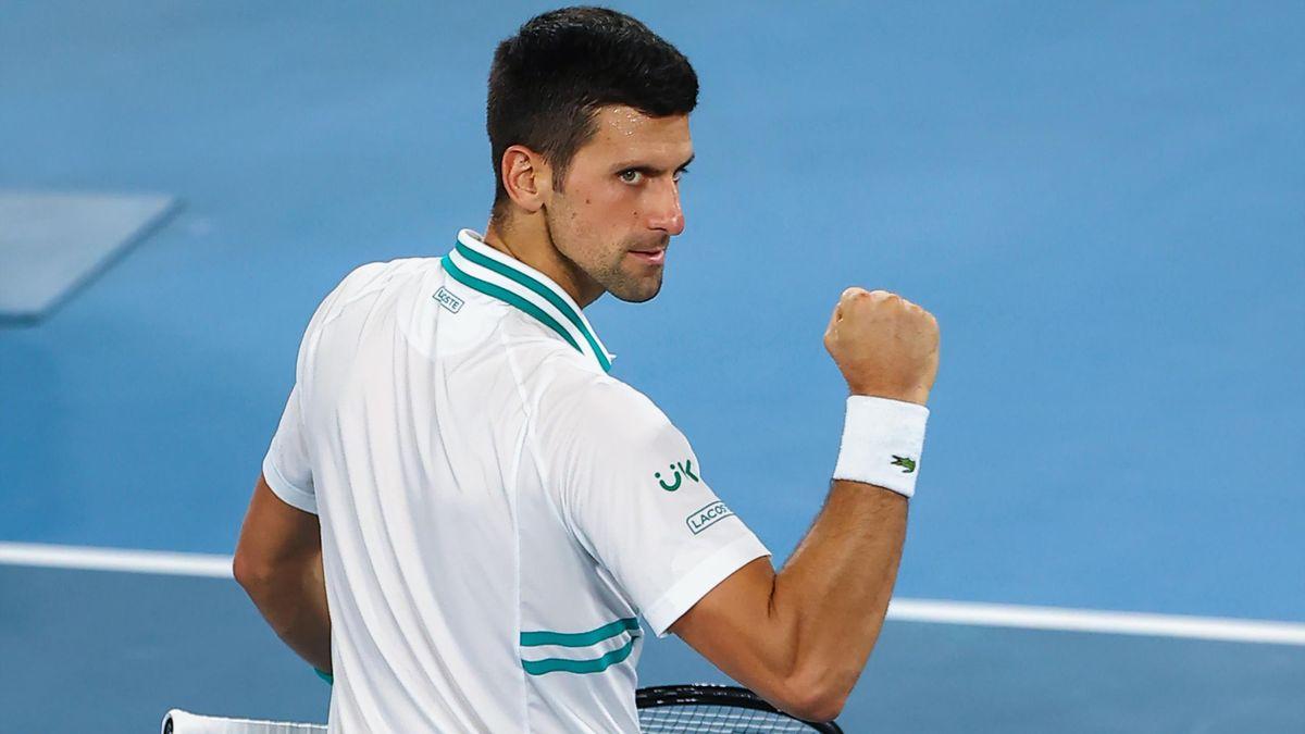 Serbia's Novak Djokovic celebrates beating Russia's Aslan Karatsev in their men's singles semi-final match on day eleven