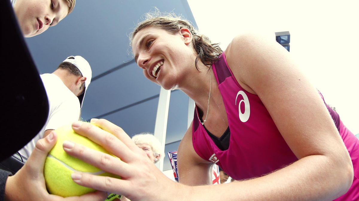 Britain's Johanna Konta signs autographs after winning her second round match against China's Zheng Saisai
