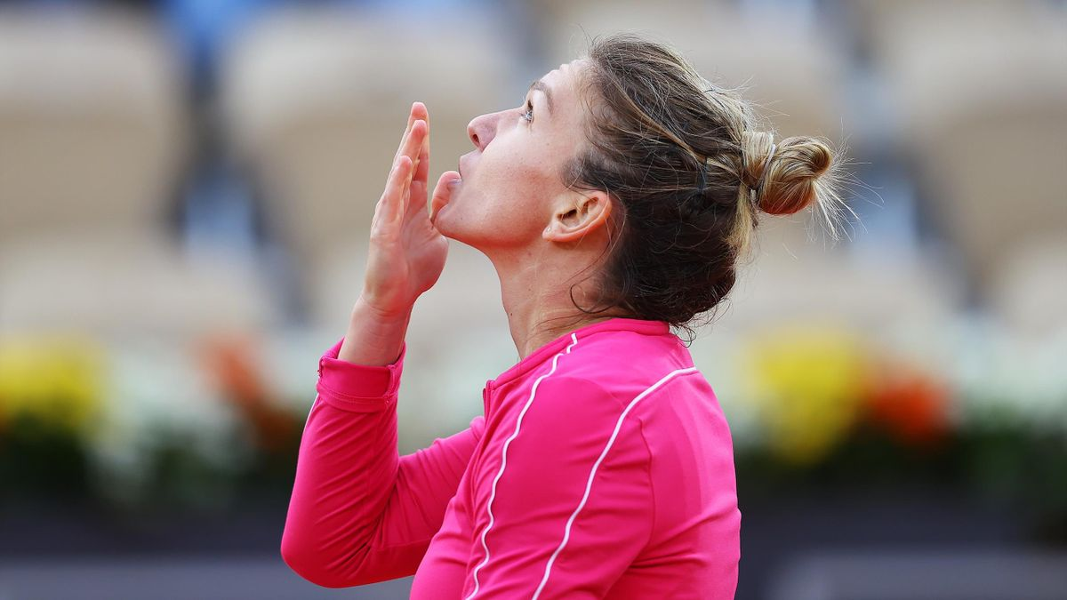Simona Halep of Romania celebrates victory following in her Women's Singles second round match against Irina-Camelia Begu of Romania on day four of the 2020 French Open at Roland Garros