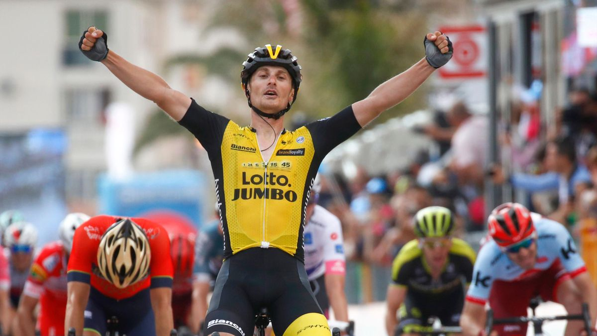 Italy's rider of team Lotto-Jumbo Enrico Battaglin celebrates as he crosses the finish line to win the 5th stage between Agrigento (Sicily) and Santa Ninfa during the 101st Giro d'Italia