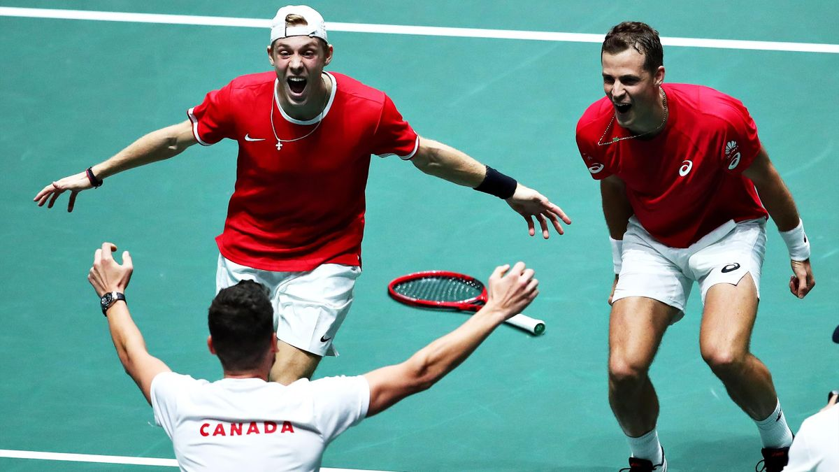 Vasek Pospisil and Denis Shapovalov of Canada celebrate with Canada team captain Frank Dancevic after winning the match in the quarter final doubles match between Australia and Canada during Day Four of the 2019 Davis Cup