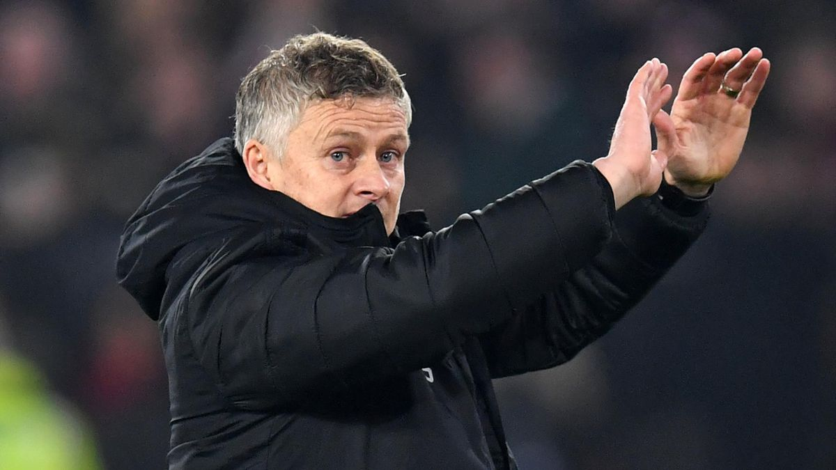 Manchester United's Norwegian manager Ole Gunnar Solskjaer gestures to supporters on the pitch after the English Premier League football match between Sheffield United and Manchester United at Bramall Lane in Sheffield, northern England on November 24, 20