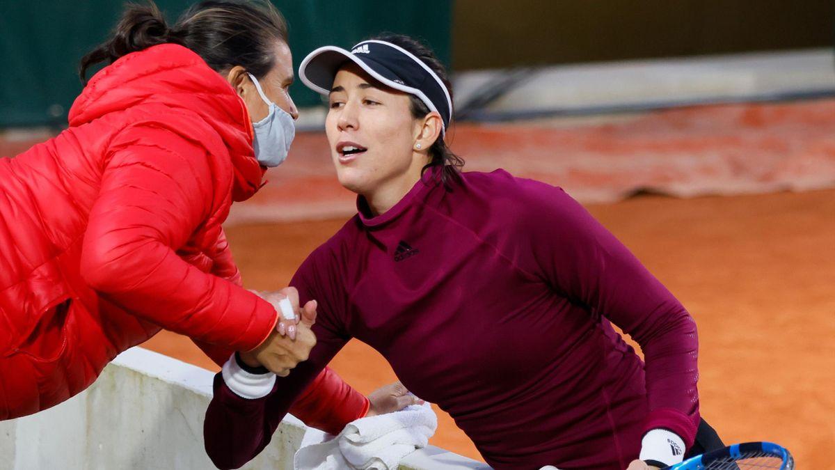 Garbine Muguruza is congratulated by her coach Conchita Martinez, French Open, Roland Garros, Paris, September 28, 2020.