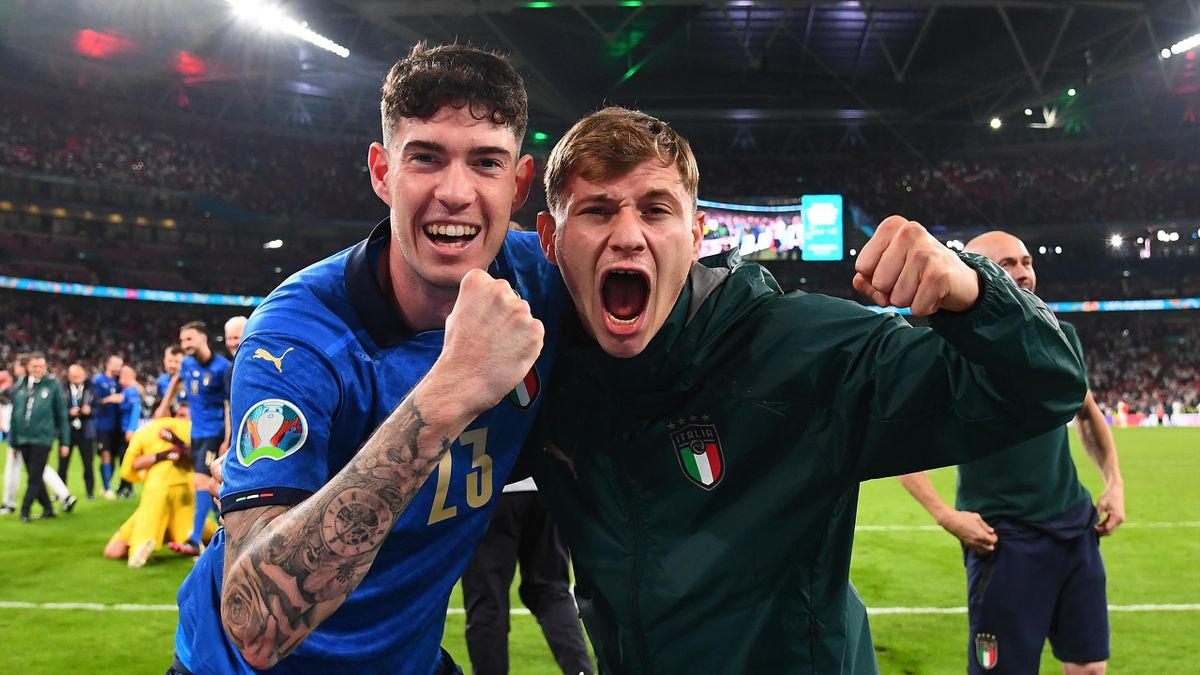 Alessandro Bastoni of Italy and Nicolo Barella of Italy celebrate following their team's victory in the UEFA Euro 2020 Championship Final between Italy and England