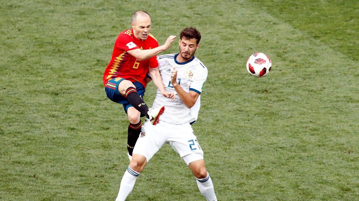 Spain's Andres Iniesta in action with Russia's Aleksandr Yerokhin
