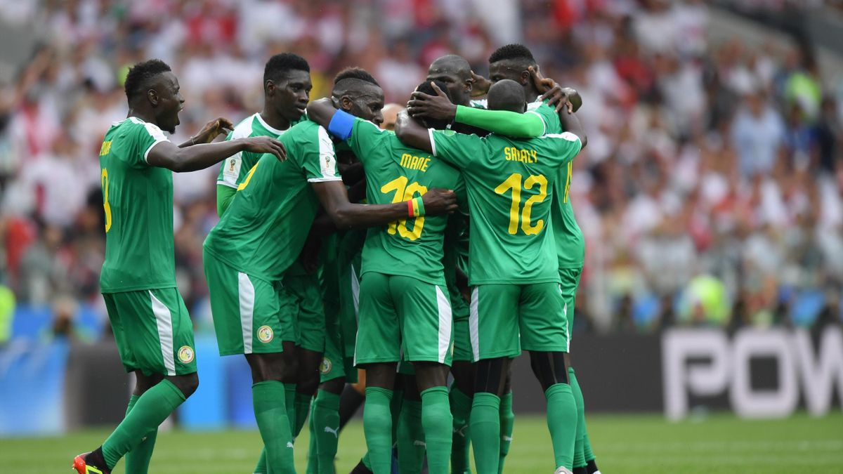 Idrissa Gana Gueye of Senegal celebrates the first Senegal goal with team mates of Senegal during the 2018 FIFA World Cup Russia group H match between Poland and Senegal at Spartak Stadium on June 19, 2018