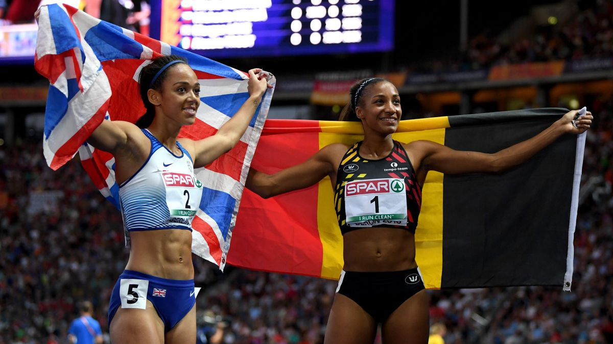 Nafissatou Thiam of Belgium and Katarina Johnson-Thompson of Great Britain celebrate after winning Gold and Silver retrospectively in the Women's Heptathlon