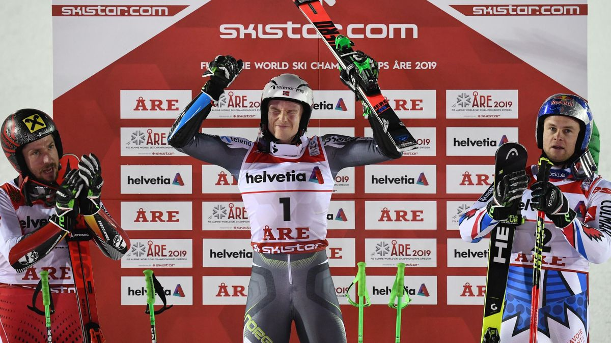 Second placed Austria's Marcel Hirscher, winner Norway's Henrik Kristoffersen, and third placed France's Alexis Pinturault celebrate after the second run of the men's Giant slalom event at the 2019 FIS Alpine Ski World Championships