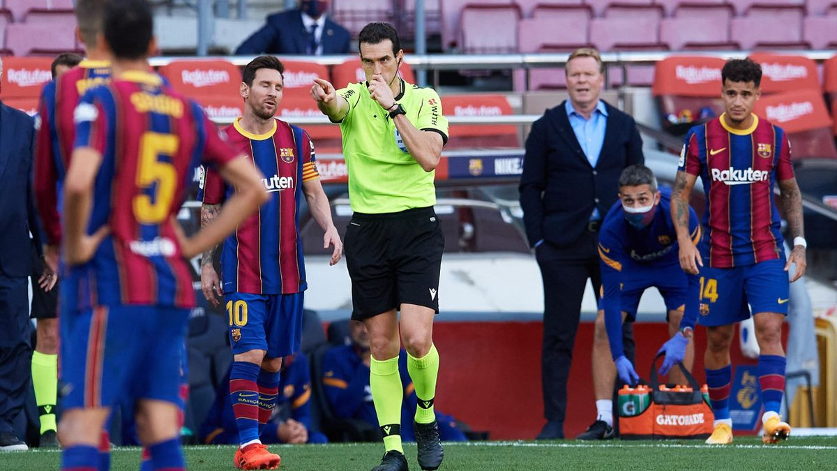 Referee Juan Martinez Munuera awards Real Madrid CF a penalty following a VAR review during the La Liga Santander match between FC Barcelona and Real Madrid at Camp Nou on October 24, 2020