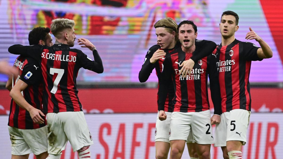 AC Milan's Italian defender Davide Calabria (2ndR) celebrates with teammates after scoring an equalizer during the Italian Serie A football match AC Milan vs Juventus on January 6, 2021 at the San Siro stadium in Milan