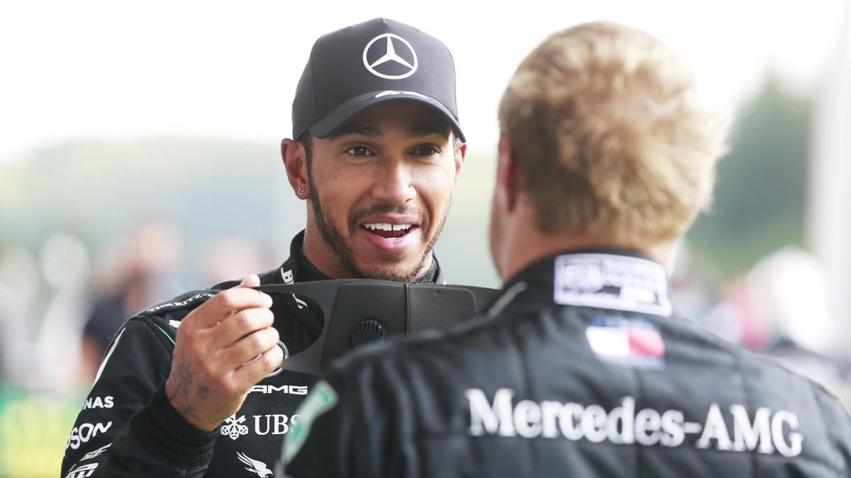 Race winner Lewis Hamilton of Great Britain and Mercedes GP speaks with teammate and second placed Valtteri Bottas of Finland and Mercedes GP in parc ferme during the F1 Grand Prix of Belgium at Circuit de Spa-Francorchamps on August 30, 2020 in Spa, Belg