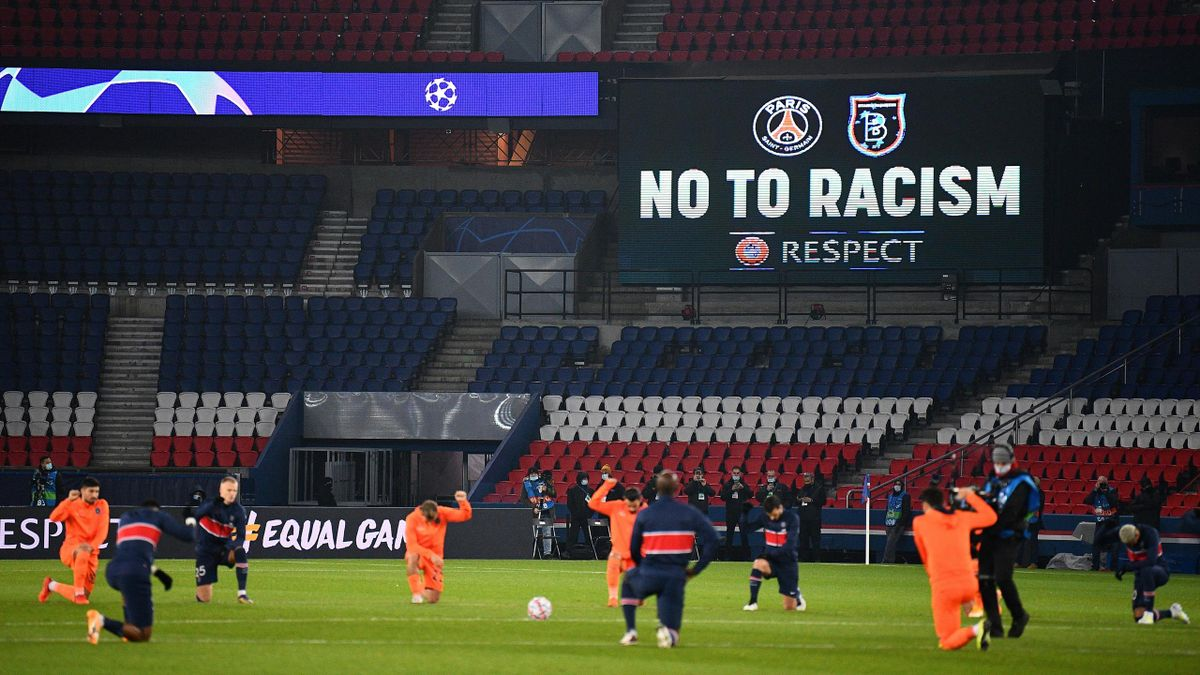 Football players and referees kneel on the pitch against racism before the UEFA Champions League group H football match between Paris Saint-Germain (PSG) and Istanbul Basaksehir FK at the Parc des Princes stadium in Paris, on December 9, 2020