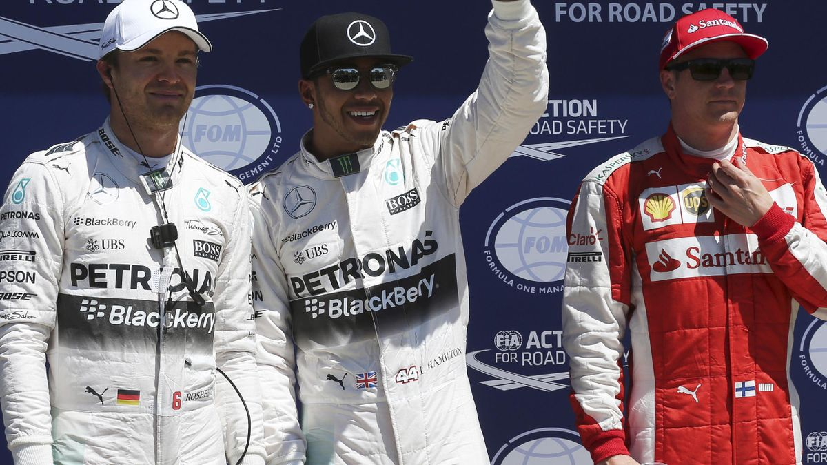 Mercedes Formula One driver Lewis Hamilton (C) of Britain poses with team mate Nico Rosberg (L) of Germany and Ferrari Formula One driver Kimi Raikkonen after qualifying for pole position ahead of the Canadian F1 Grand Prix in Montreal