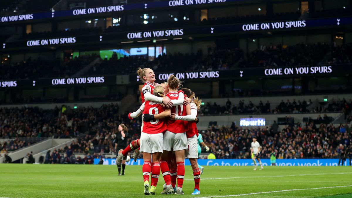 Kim Little of Arsenal jumps up as the team celebrate Vivianne Miedema scoring her side's second goal during the Women's Super League match against Tottenham Hotspur at White Hart Lane on November 17, 2019.