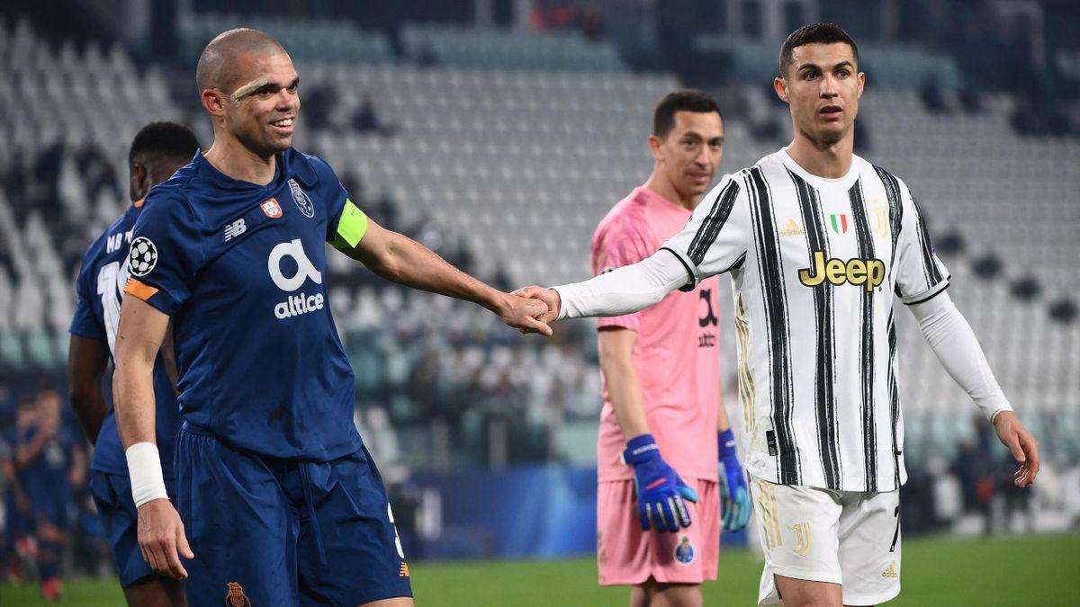 Pepe shakes hands with Cristiano Ronaldo