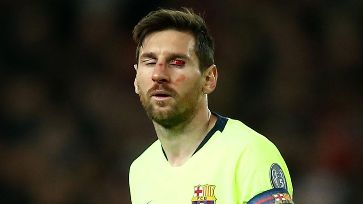 Lionel Messi of Barcelona looks on injured during the UEFA Champions League Quarter Final first leg match between Manchester United and FC Barcelona at Old Trafford on April 10.