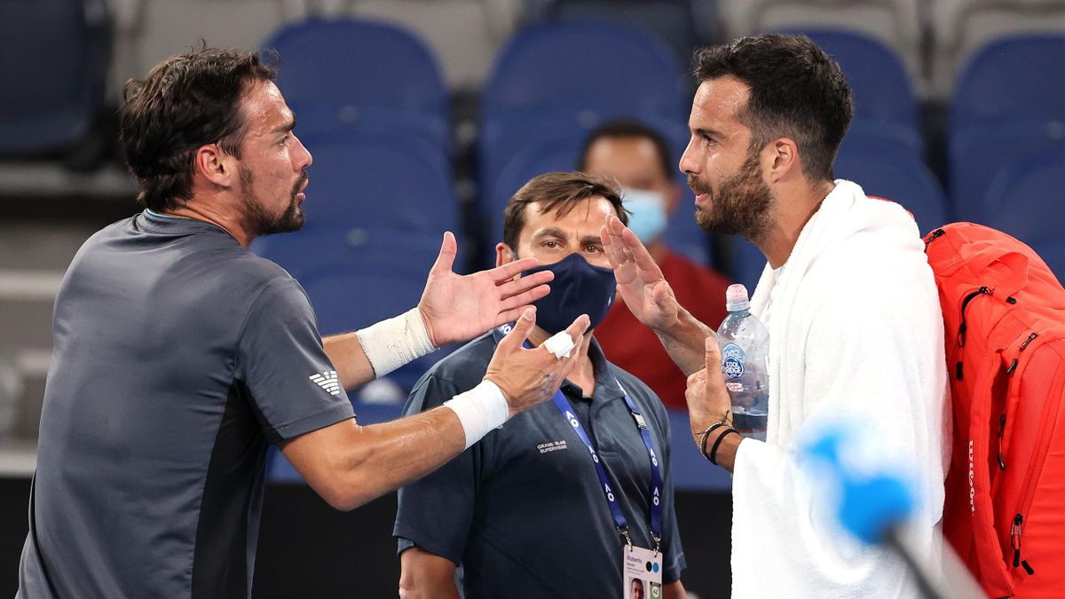 Italian player Salvatore Caruso (R) and Fabio Fognini argue after their men's singles match on day four of the Australian Open tennis tournament