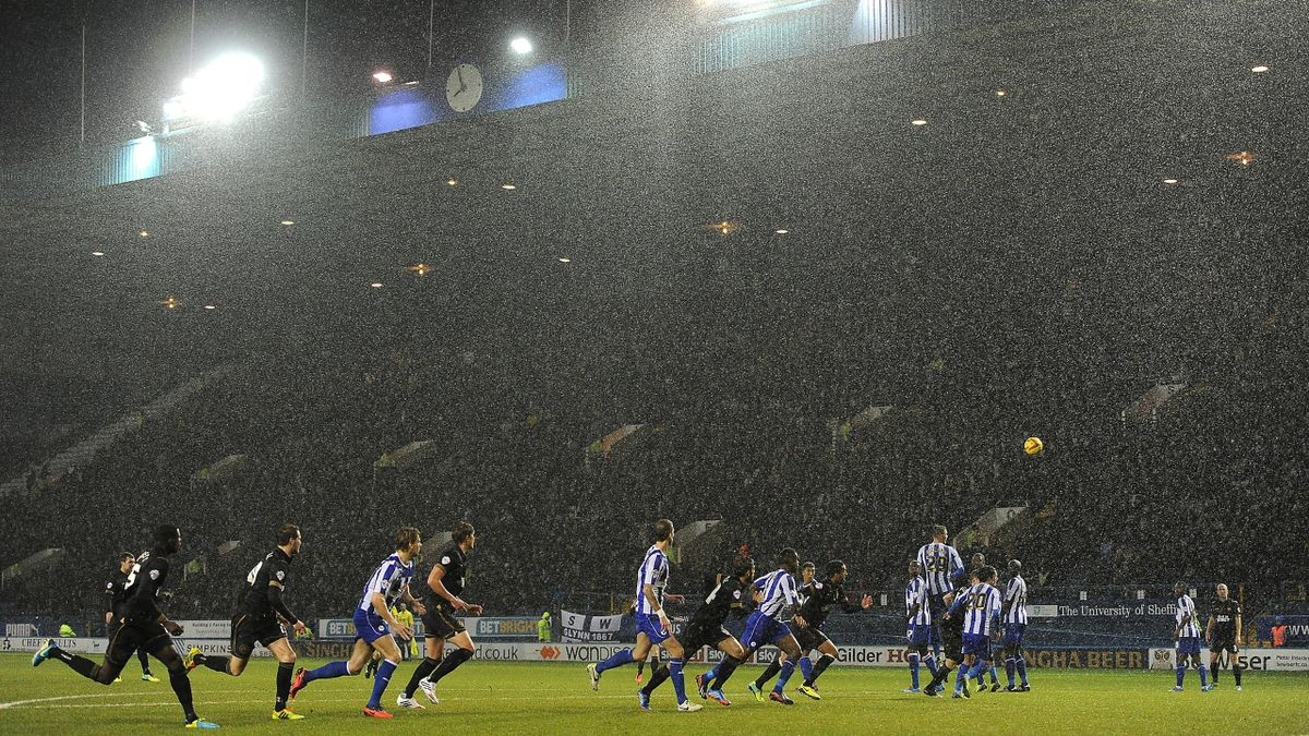 A general view of action between Sheffield Wednesday and Wigan Athletic as heavy rain falls (PA Photos)