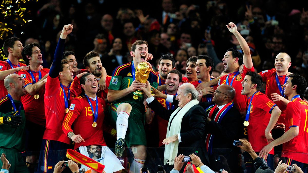 Iker Casillas of Spain celebrates as he is presented the World Cup by FIFA President Joseph Sepp Blatter and President of South Africa Jacob Zuma during the 2010 FIFA World Cup South Africa Final match between Netherlands and Spain at Soccer City Stadium