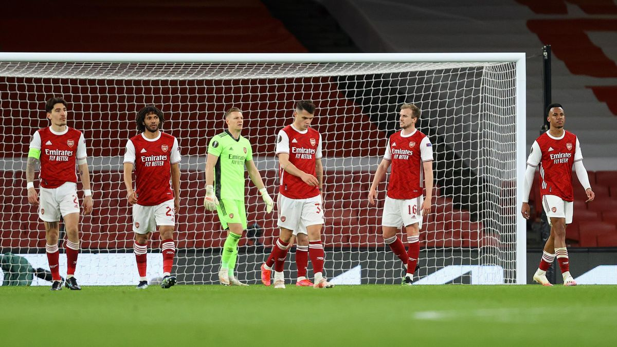 Players of Arsenal looks dejected after conceding their side's first goal scored by Tomas Holes of Slavia Praha