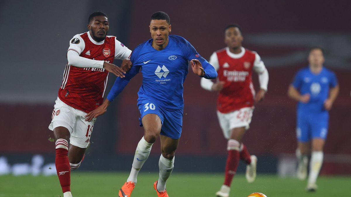 Mathis Bolly of Molde controls the ball under pressure from Ainsley Maitland-Niles