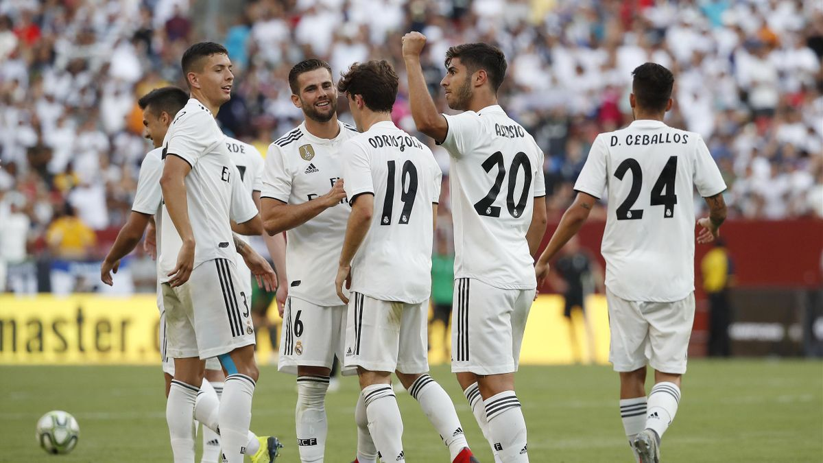 Marco Asensio #20 of Real Madrid celebrates with his teammates