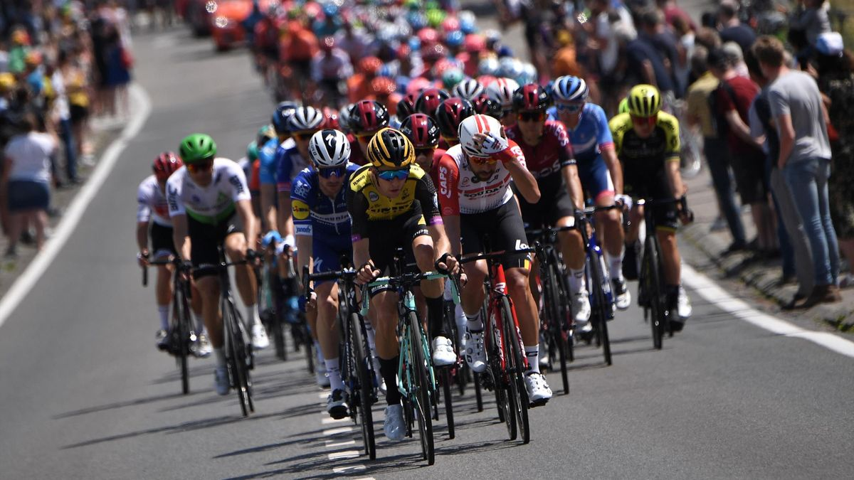 The pack rides in the first stage of the 106th edition of the Tour de France cycling race between Brussels and Brussels, Belgium, on July 6, 2019.