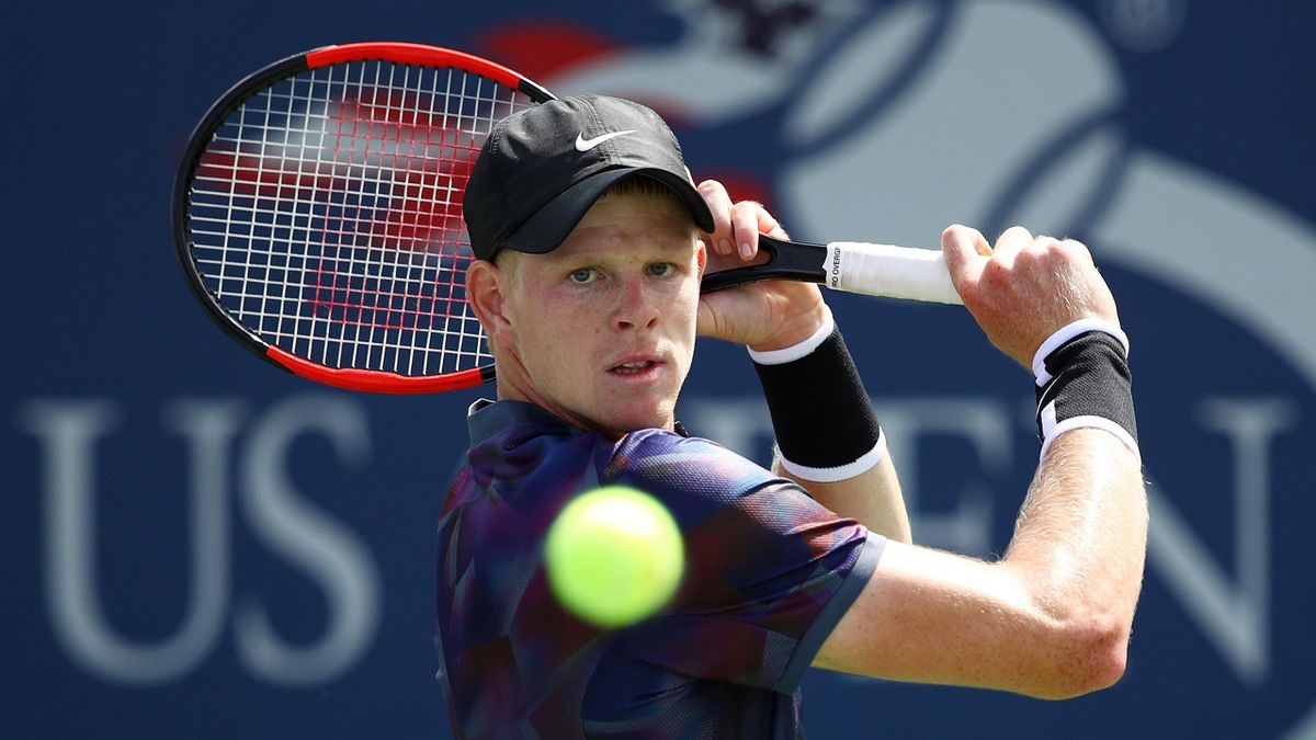 Kyle Edmund of Great Britain returns a shot during his first round Men's Singles match against Robin Haase