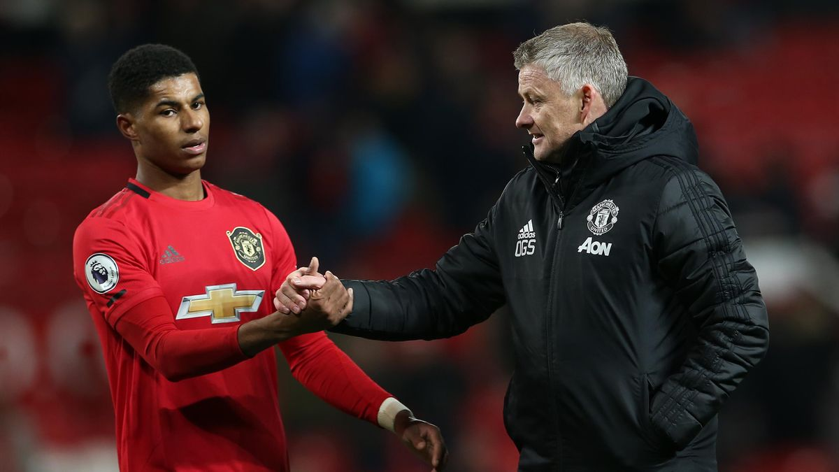 MANCHESTER, ENGLAND - DECEMBER 01: Manager Ole Gunnar Solskjaer and Marcus Rashford of Manchester United walk off after the Premier League match between Manchester United and Aston Villa at Old Trafford on December 01, 2019 in Manchester, United Kingdom.