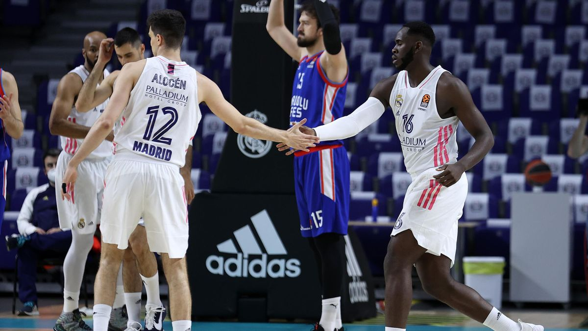 Usman Garuba, #16 and Carlos Alocen, #12 of Real Madrid shake hands during the 2020/2021 Turkish Airlines Euroleague Play Off Game 3 between Real Madrid and Anadolu Efes Istanbul at Wizink Center on April 27, 2021 in Madrid, Spain