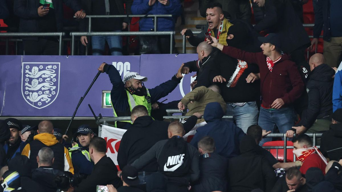 Hungary fans fight with Police during the 2022 FIFA World Cup Qualifier match between England and Hungary at Wembley Stadium on October 12, 2021 in London, England.