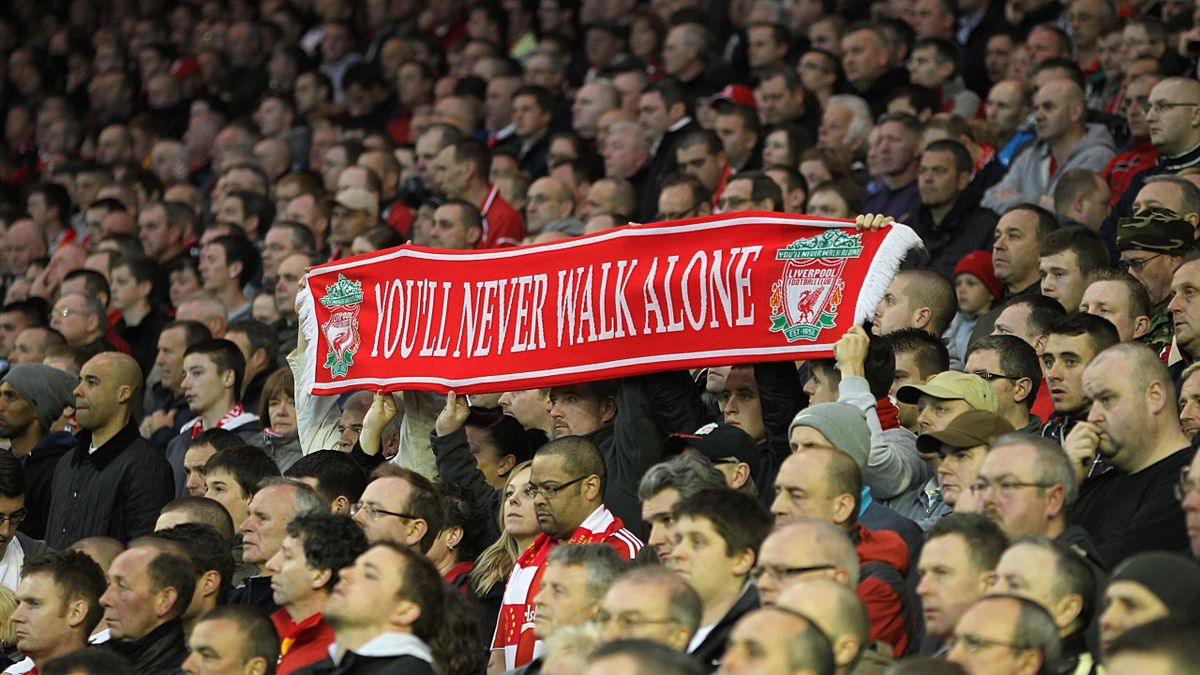 Barclays Premier League, Liverpool v Manchester City, Anfield, Liverpool fans display a scarf in the stands with the words You'll Never Walk Alone as they take part in a minute's silence in memory of the HIllsborough disaster