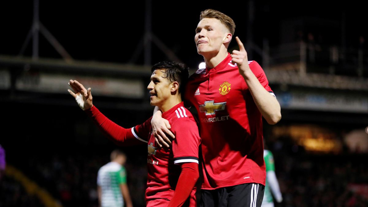 Manchester United's Alexis Sanchez celebrates their second goal with Scott McTominay