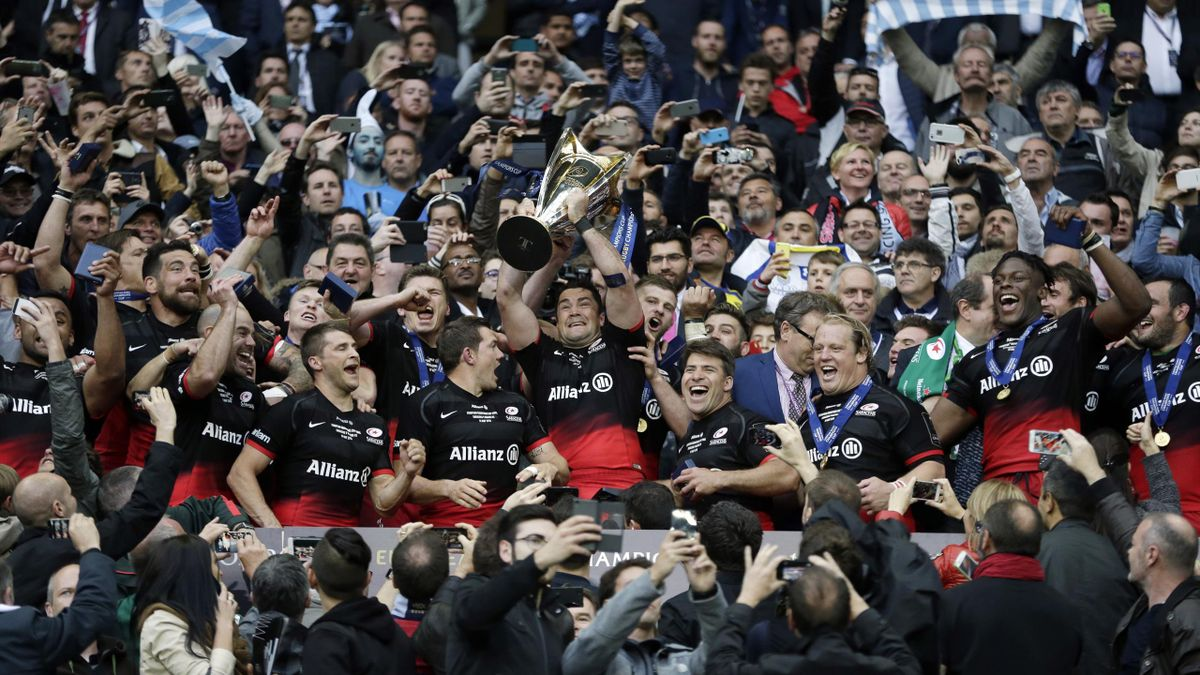 Saracens' celebrate winning the European Rugby Champions Cup Final with the trophy.