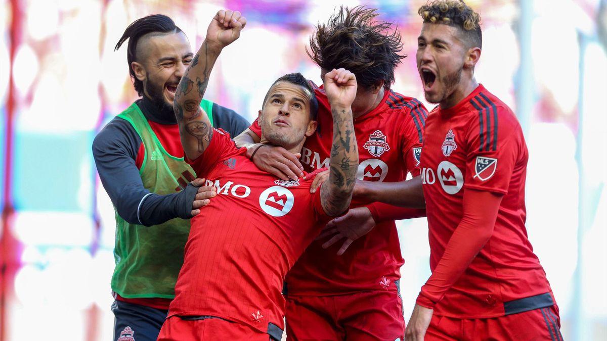 Toronto FC forward Sebastian Giovinco (10) celebrates his goal against the New York Red Bulls during the second half at Red Bull Arena. Toronto FC won, 2-0.