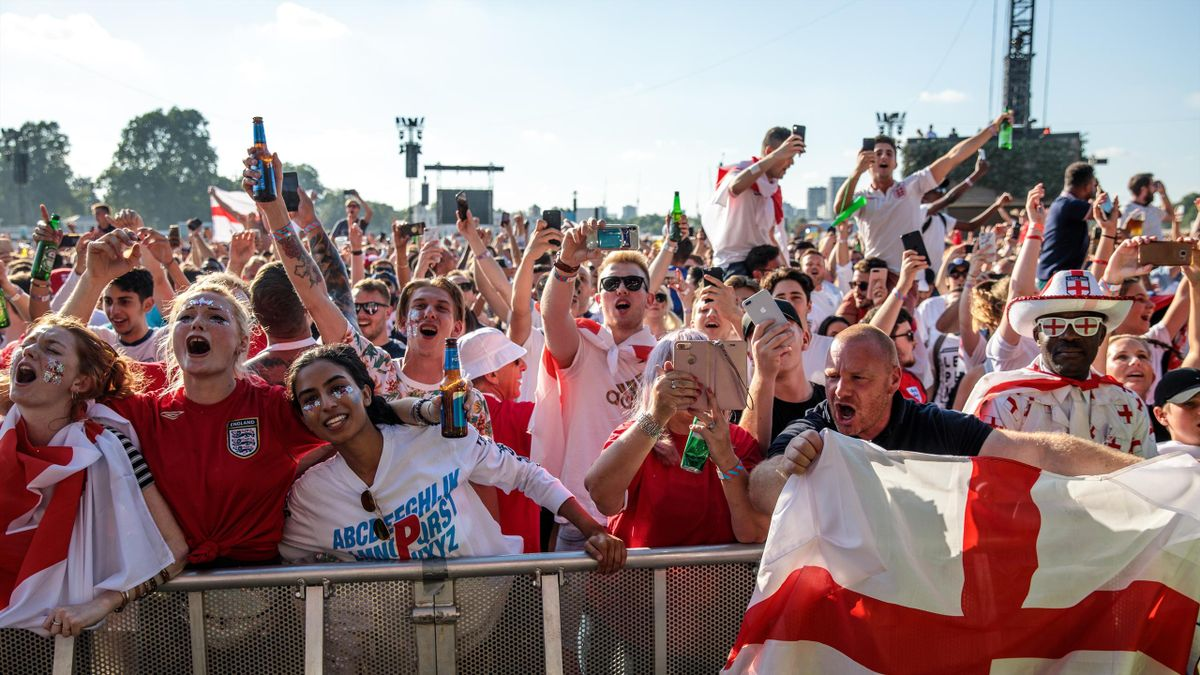 England football fans sing during a performance by the British band the Lightning Seeds ahead of a Hyde Park screening of the FIFA 2018 World Cup