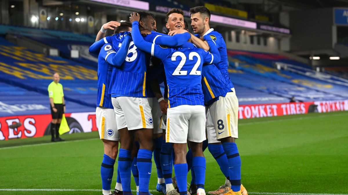 Danny Welbeck of Brighton & Hove Albion celebrates with his team mates after scoring his team's first goal during the Premier League match between Brighton & Hove Albion and West Ham United at American Express Community Stadium on May 15, 2021 in Brighton