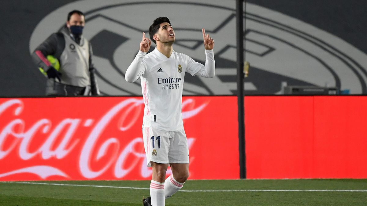 Real Madrid's Spanish midfielder Marco Asensio celebrates after scoring a goal during the Spanish League football match between Real Madrid and Celta Vigo at the Alfredo Di Stefano stadium