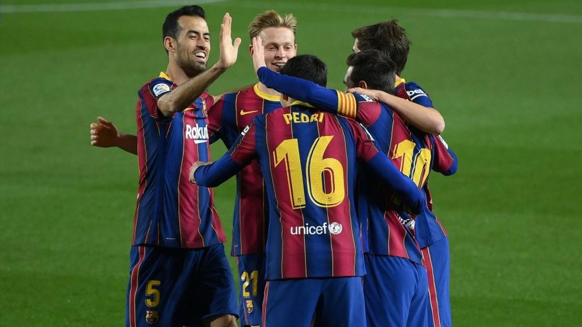 Barcelona's Argentinian forward Lionel Messi (R) celebrates with teammates after scoring a goal during the Spanish League football match between Barcelona and Getafe at the Camp Nou stadium in Barcelona on April 22, 2021.