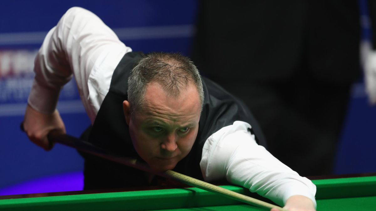 John Higgins of Scotland in action in the final against Mark Selby of England on day sixteen at Crucible Theatre on April 30, 2017 in Sheffield, England.