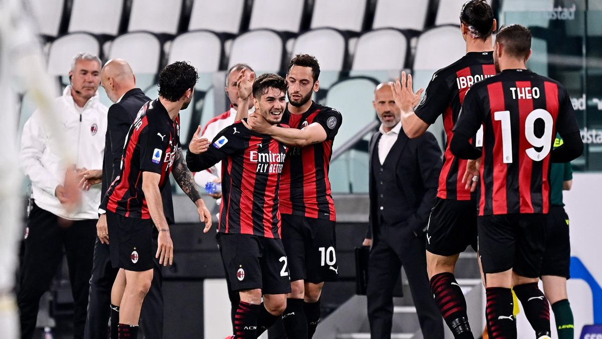 Brahim Diaz of AC Milan Celebrates 0-1 with teammates during the Italian Serie A match between Juventus v AC Milan at the Allianz Stadium on May 9, 2021 in Turin