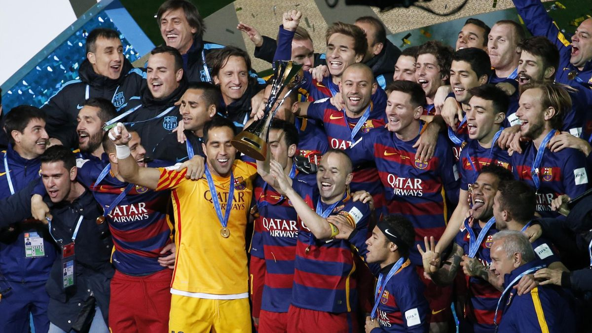 Barcelona celebrate winning the FIFA Club World Cup Final with the trophy